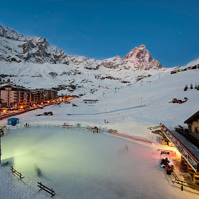 cervino mountain on the night by Vincenzo Bernardi - Landscapes Mountains & Hills ( climb, moon, detail, icy, europe, mountain, peak, rocky, rock, landscape, recreation, swiss, march, danger, sky, ice, snow, weather, matterhorn, italy, alps, top, orientation, extreme, peaceful, symbol, white, cervino, dangerous, climbing, winter, blue, cervinia, stars, sunset, peace, cloud, town, hotel, cold,  )