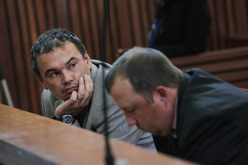 From left: Willem Oosthuizen and Theo Jacobs appear at the High Court sitting at the Middleburg Magistrates court in Mpumalanga ahead of sentencing proceedings. The pair have been convicted of assault after forcing Victor Mlotshwa into a coffin and threatening to set him alight. Picture: Alaister Russell/The Times