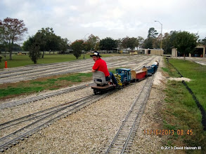 Photo: David James pulling a car set plus one car into the station.    2013-1116 DH3