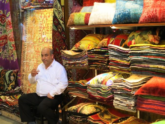 Shop owner sipping tea in the Grand Bazaar