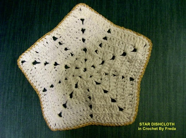 This is the Star Dishcloth in Crochet that is trimed in Gold I am making for all My daughters employees for 2011