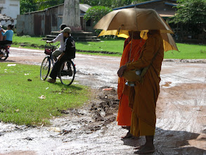 Photo: Monks in a downpour