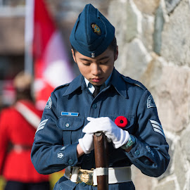 Solemn Moment by Garry Dosa - People Street & Candids ( head lowered, flag, poppy, remembrance day, uniforms, people, red, standing, celebration, blue, outdoors, white, ceremony, solemn, male, rifle )