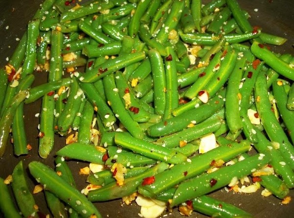 Add the beans and toss to coat with garlic. Salt and pepper and saute...