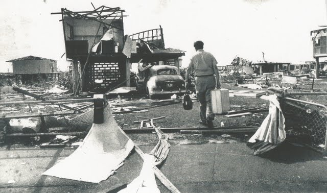 Photo: NT policeman Lynn Cox returns to his house in Darwin after Cyclone Tracey in 1974