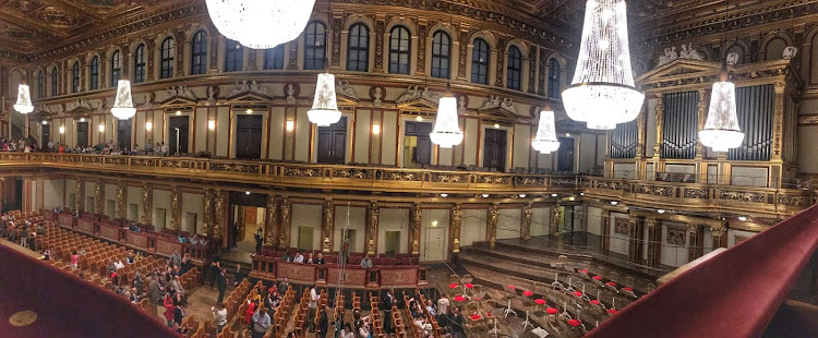 Inside Musikverein before a performance by a 30-musician ensemble.