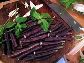 Photo: cut purple long beans and mint sprigs to accompany fish salad