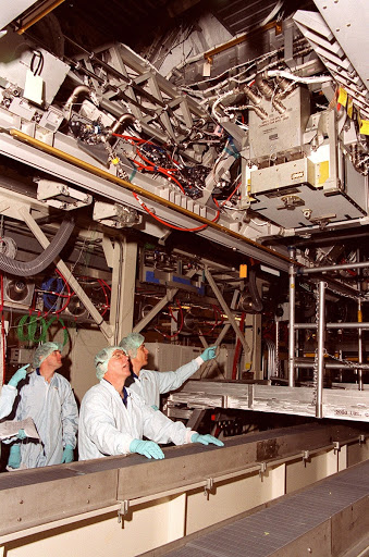 Members of the STS-110 crew check out Integrated Truss Structure ITS S0 which is in the Operations and Checkout Building.