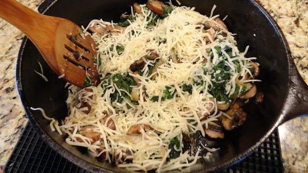Add Swiss cheese to pan with vegetables and stir to a uniform distribution of...