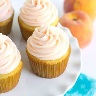 Yellow Cupcakes with Peach Cream Cheese Frosting.