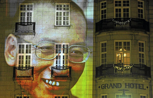 A Nobel honour:  An image of Liu Xiaobo is projected on a hotel in the centre of Oslo following the Nobel Peace Prize ceremony in Norway in 2010. Liu was represented at the award ceremony by an empty chair. Picture: REUTERS