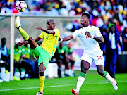 Thabo Matlaba of South Africa challenged by Keita Balde of Senegal during 2018 World Cup Qualifiers match between South Africa and Senegal at Peter Mokab Stadium, November on the 12 November 2016 ©  / Samuel Shivambu / BackpagePix