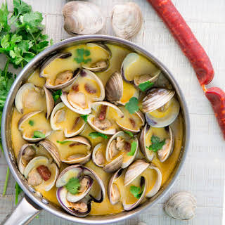 PORTUGUESE CLAMS STEW with chorizo and white wine sauce.