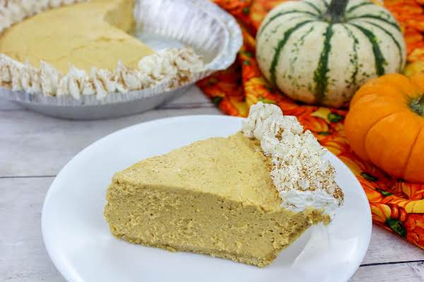 A Slice Of No-bake Pumpkin Cheesecake On A Plate.