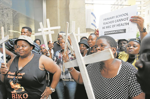 Family members of psychiatric patients who died earlier this year hold an 'Esidimeni 37' prayer vigil outside Gauteng Health MEC Qedani Mahlangu's offices yesterday. The 37 patients died after being transferred from Life Esidimeni into the care of NGOs. Findings of the investigation into the tragedy would be released next month, health ombudsman Professor Malegapuru Makgoba said. Picture Creditc: Antonio Muchave. ©Sowetan