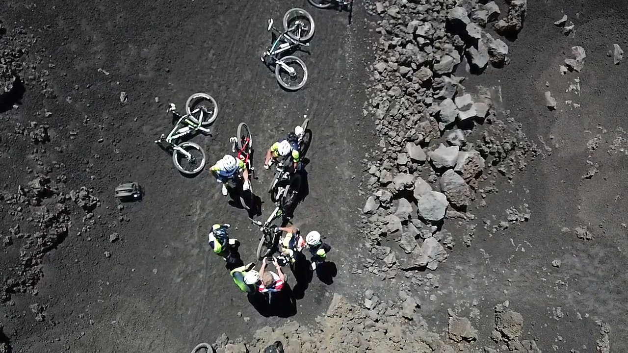 Drone photo on top of Mount Etna of cyclists.