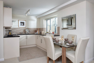 Photo: Light flooded kitchen with dining table