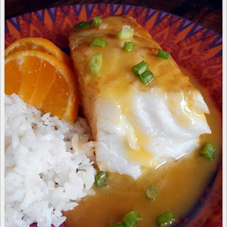 Chilean Sea Bass with Orange Mango White Wine Reduction.