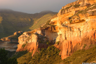 Photo: Sandstone cliffs in the the last rays of the setting sun. Golden Gate Highlands National Park (South Africa).