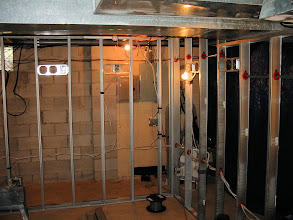 Photo: Left back corner of theater. New electrical panel can be seen in the rear access area.