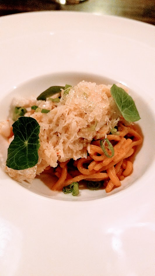 Twisted Filipino December Dinner by Carlo Lamagna Course 5: Alimasag, aka how my mom cooks noted Carlo, a dish of dungeness crab, crab roe, housemade alkaline noodles, fingerlime, and chicharron