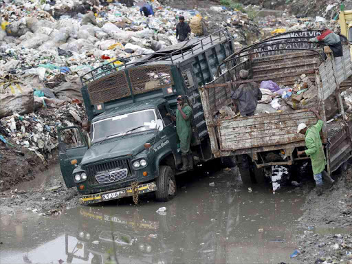 Trucks transport garbage to the Dandora dumpsite on June 5 last year