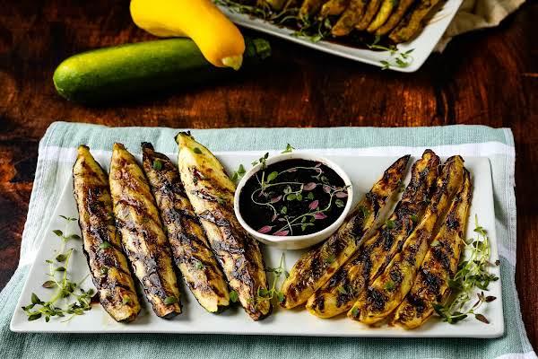 A Platter Of Grilled Squash With Balsamic Drizzle.