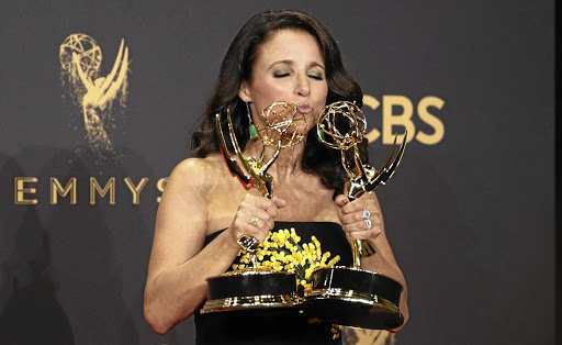 Julia Louis-Dreyfus holds her Emmys for outstanding lead actress in a comedy series and outstanding comedy series for Veep. Picture: REUTERS