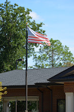 Photo: One might think that the bank owned by the richest family in this and surrounding counties could afford a new new flag every so often.