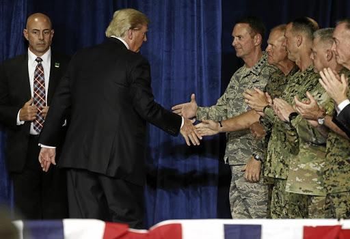 US President Donald Trump shakes hands with military officers as he departs after announcing his strategy for the war in Afghanistan during an address to the nation from Fort Myer, Virginia, on August 21 2017. Picture: REUTERS