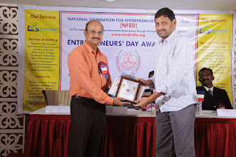 Photo: Chief Guest Mr. A. Devi Dutt Issuing Senior  Entrepreneur Award to Mr. R. Murugesan, Managing Partner, Sakthi Murugan Agencies, Coimbatore