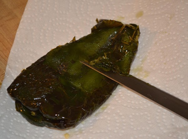 Remove peppers from oil, and place onto a paper towel to soak up oil....
