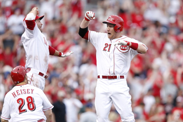 CINCINNATI, OH - MAY 4: Todd Frazier #21 of the Cincinnati Reds celebrates his winning hit with teammate Joey Votto #19 following the game against the Milwaukee Brewers at Great American Ball Park on May 4, 2014 in Cincinnati, Ohio. The Reds won 4-3 in ten innings. (Photo by Joe Robbins/Getty Images)