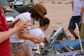 Photo: Hard at work on the Eris Project rover's manipulator before the Sample Return Task.