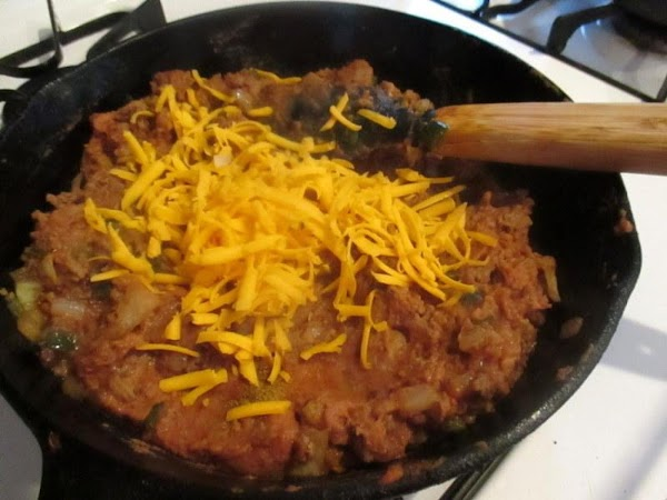 Once tender crisp, add the meat back to pan and the refried beans, seasonings,...
