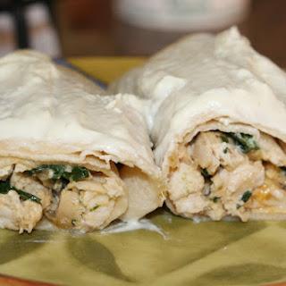 Cheesy Chicken Spinach Enchiladas in Jalapeño Cream Sauce