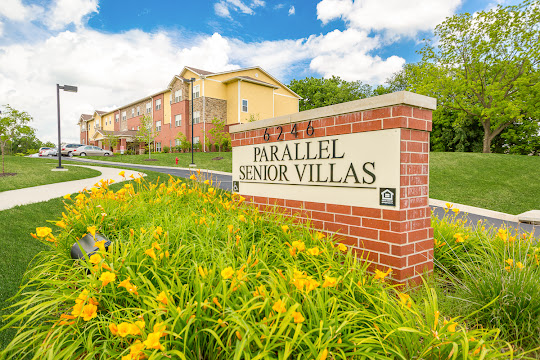 Parallel Senior Villas sign with flowers surrounding