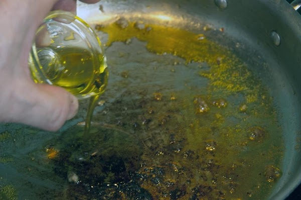 Remove all but a tablespoon of the oil from the pan, add 1-tablespoon olive...