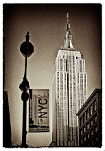 Photo: I've been looking through some older images that I took in New York City in anticipation of a visit I'll be making there in about a week. This is a shot I took on an early morning walk around Manhattan back in 2007 showing the Empire State Building. I liked the look of the early morning sun on the building, but the sky was perfectly clear and the overall image was rather boring so I decided to play around in Color Efex Pro 4 and Silver Efex Pro 2 to come up with something different. The final image relied heavily on one of the Film Noir presets found in Silver Efex Pro 2.  I'm looking forward to my trip and hope to come back with some new images to share.  #SepiaSaturday curated by +Renee Stewart Jackson