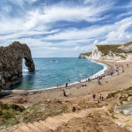 Durdle Door Beach (UK) by Gianluca Presto - Landscapes Beaches ( sky, cliffs, rocks, waterscape, united kingdom, beach, travel, people, landscape, sea )