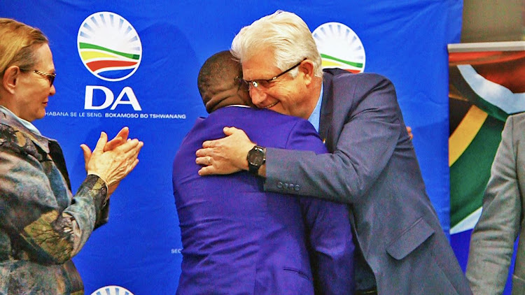 Alan Winde embraces DA's Western Cape leader Bonginkosi Madikizela after being nominated as the DA's Western Cape premier candidate on September 19 2018.