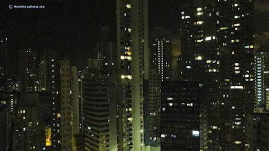 Photo: Hong Kong apartments at night.