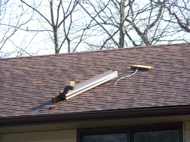 Photo: One of the neighbors roofs liked our roof better. After picking it off the root it became clear we had two small holes, both of which now have temporary patches.