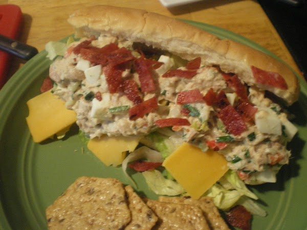On sandwich roll place chopped lettuce, slice cheese, and a spoon tuna filling. ...