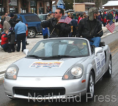 Photo: Nisswa's Mayor, Brian Lehman, and Citizen of the Year, Mark Ulm,  enjoy the parade - photo by Joanne Boblett