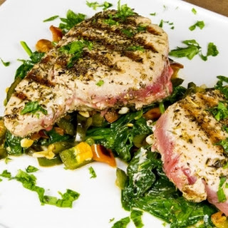Seared Tuna Over Sauteed Spinach and Peppers.