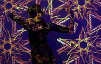 Photo: HiFiDreams Projected onto Hannah Thiem, Boston Cyberarts Festival 2007.