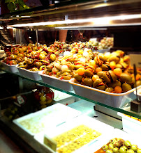 Photo: Mercado de San Miguel.  Gourmet market food market with a great selection of Spanish  foods and drinks for sampling.  Stuffed olives.  Madrid.