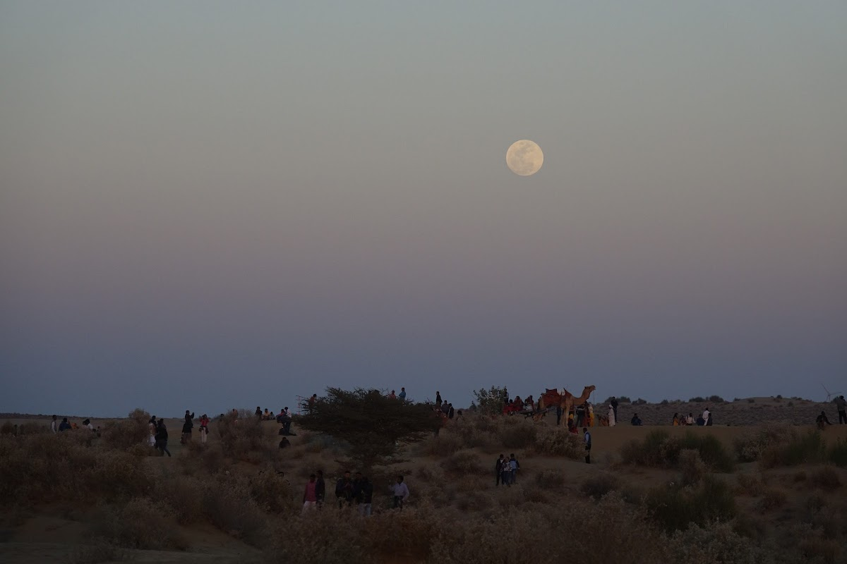 India. Rajasthan Thar Desert Camel Trek. Full moon over the Kadar sand dunes, Thar Desert