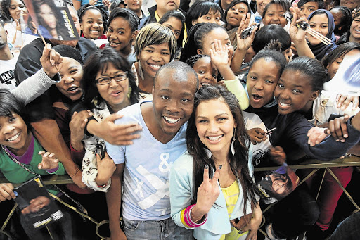 The finalists on 'Idols SA', Durban's Khaya Mthethwa and Port Elizabeth's Melissa Allison, are mobbed by fans in Cape Town ahead of their showdown tonight Picture: COBUS BODENSTEIN